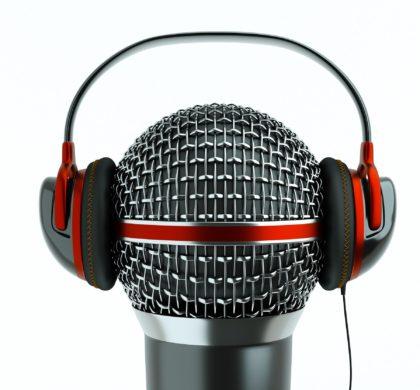 10768023 - a single microphone with headphones on white, a speak and listen concept